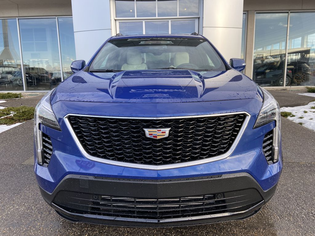 Blue[Wave Metallic] 2021 Cadillac XT4 Sport Front Vehicle Photo in Calgary AB