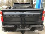 Gray[Shadow Grey Metallic] 2021 Chevrolet Silverado 1500 LT Trail Boss Rear of Vehicle Photo in Canmore AB
