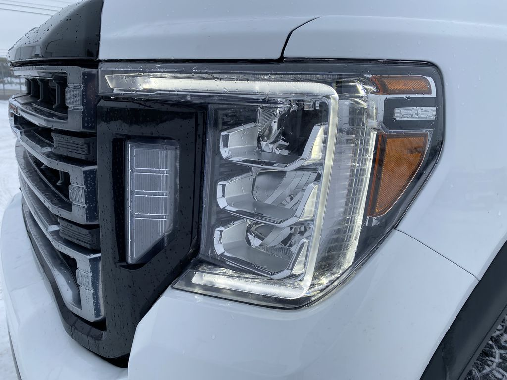 White[Summit White] 2021 GMC Sierra 2500HD Left Front Head Light / Bumper and Grill in Edmonton AB