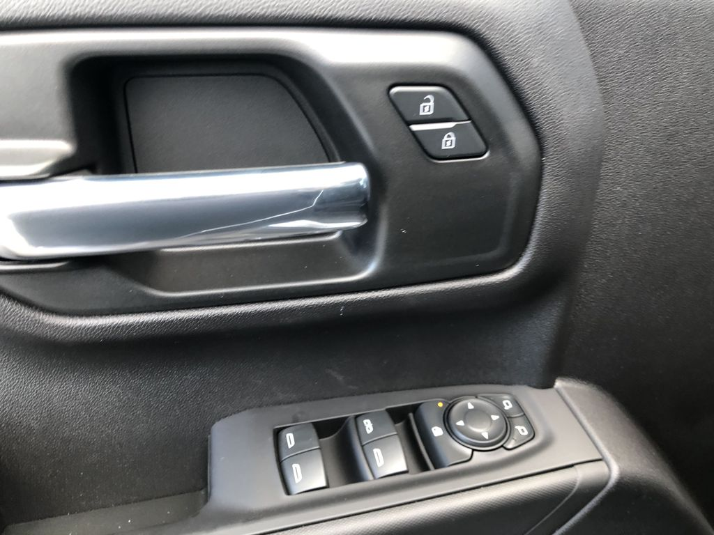 Silver[Silver Ice Metallic] 2021 Chevrolet Silverado 1500 Custom  Driver's Side Door Controls Photo in Canmore AB