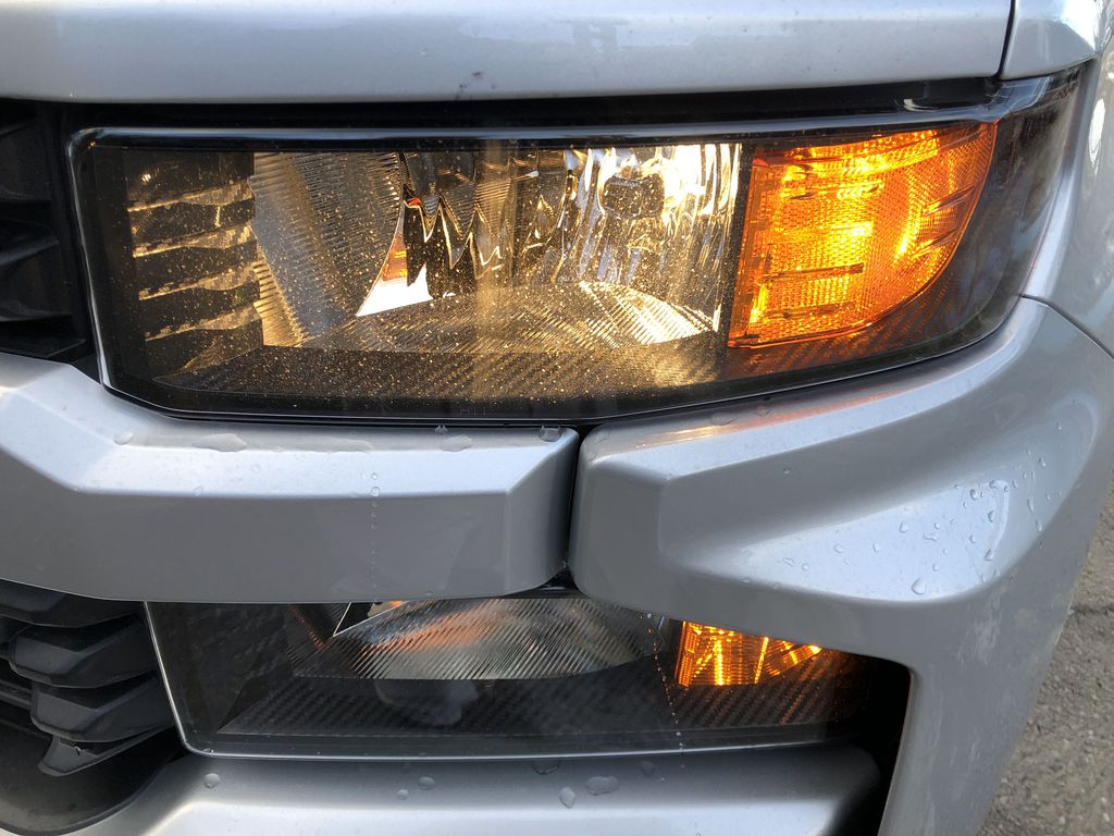 Silver[Silver Ice Metallic] 2021 Chevrolet Silverado 1500 Custom Left Front Head Light / Bumper and Grill in Canmore AB