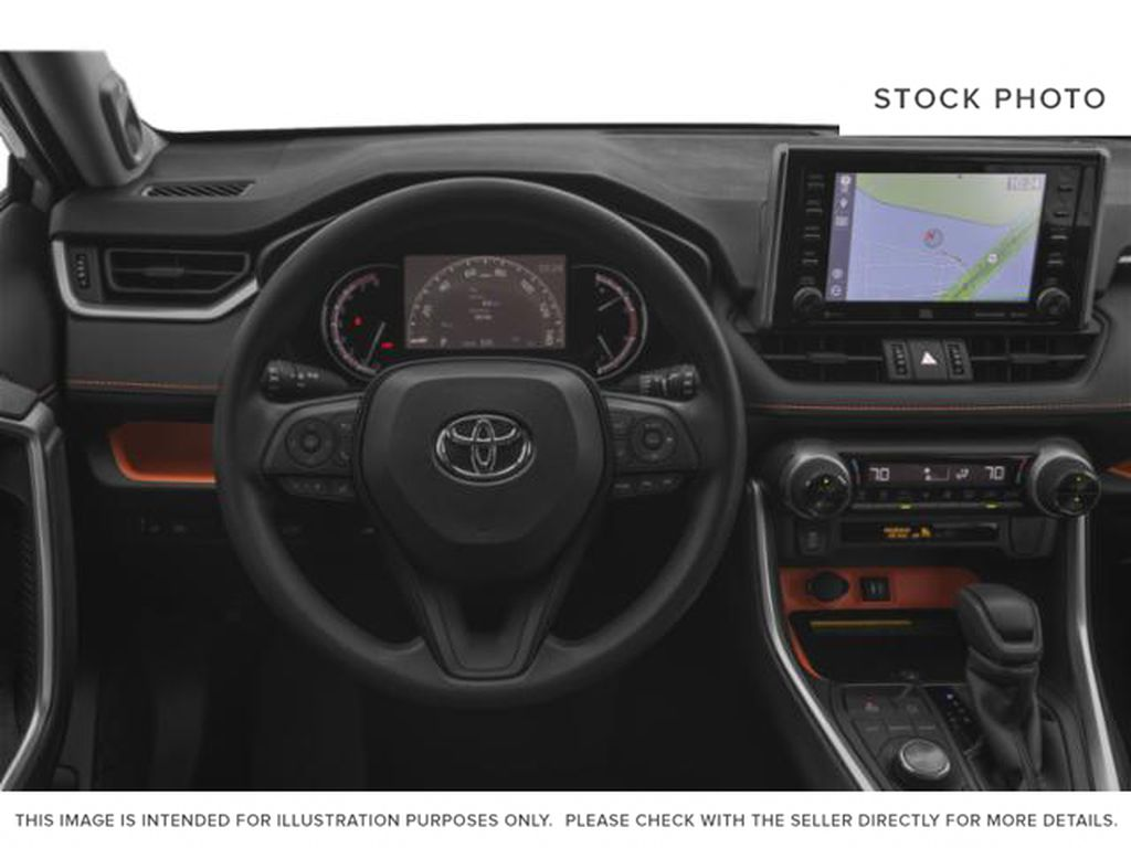 Red[Ruby Flare Pearl] 2021 Toyota RAV4 Trail Steering Wheel and Dash Photo in Kelowna BC