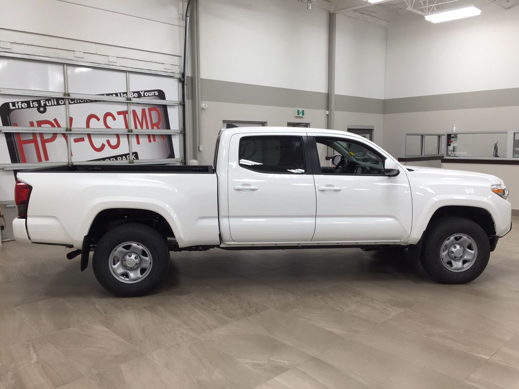 White[Super White] 2021 Toyota Tacoma Right Side Photo in Sherwood Park AB