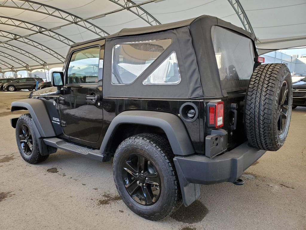 Black 2018 Jeep Wrangler JK Center Console Photo in Airdrie AB
