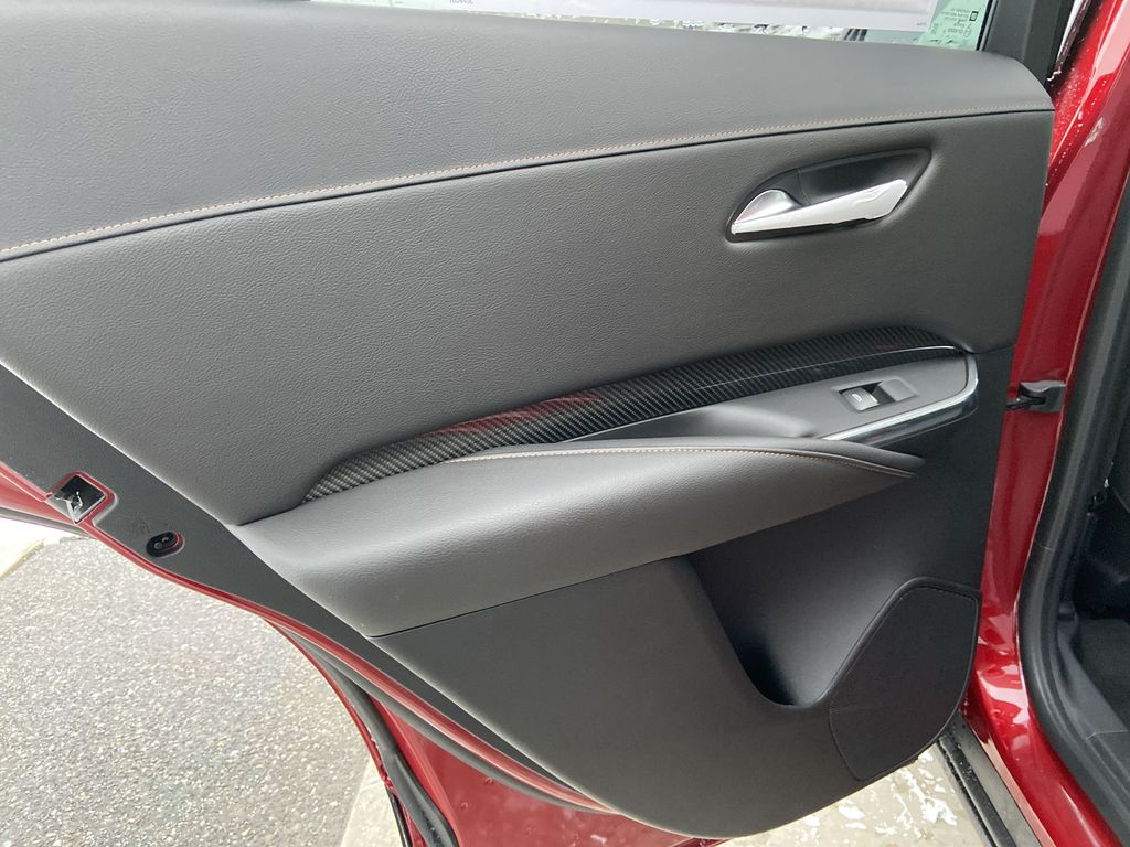 Red[Infrared Tintcoat] 2021 Cadillac XT4 Sport Left Rear Interior Door Panel Photo in Calgary AB