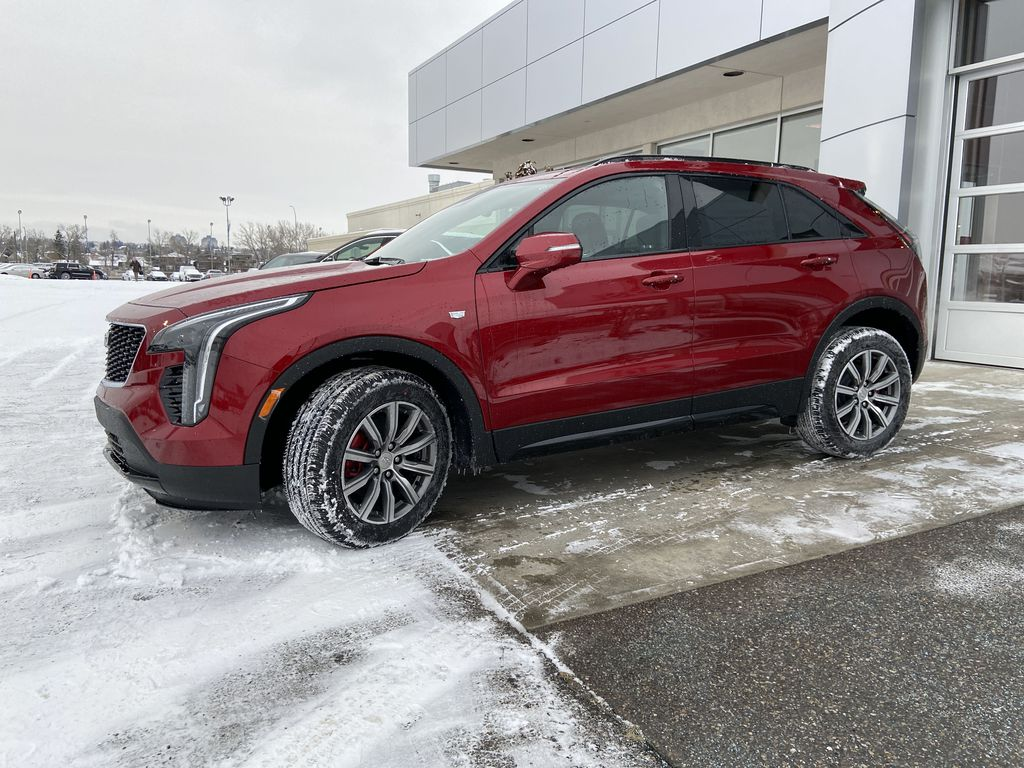 Red[Infrared Tintcoat] 2021 Cadillac XT4 Sport Left Front Corner Photo in Calgary AB