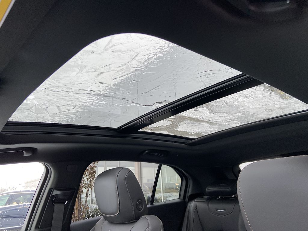 Red[Infrared Tintcoat] 2021 Cadillac XT4 Sport Sunroof Photo in Calgary AB
