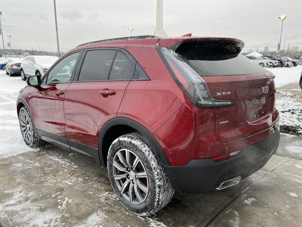 Red[Infrared Tintcoat] 2021 Cadillac XT4 Sport Left Rear Corner Photo in Calgary AB