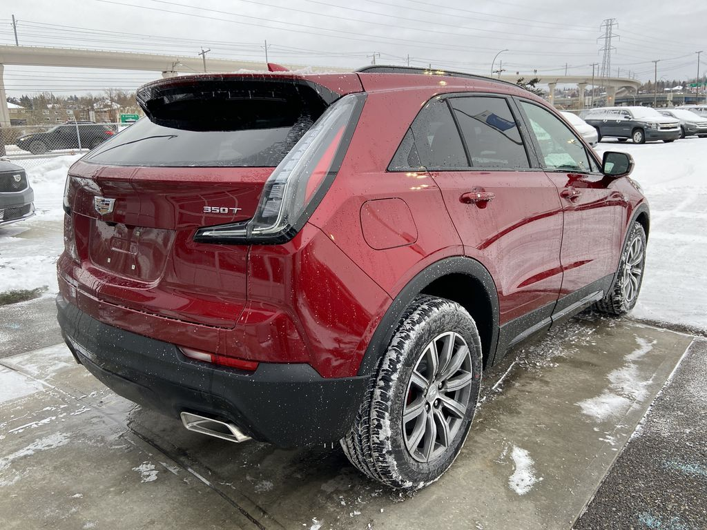 Red[Infrared Tintcoat] 2021 Cadillac XT4 Sport Right Rear Corner Photo in Calgary AB
