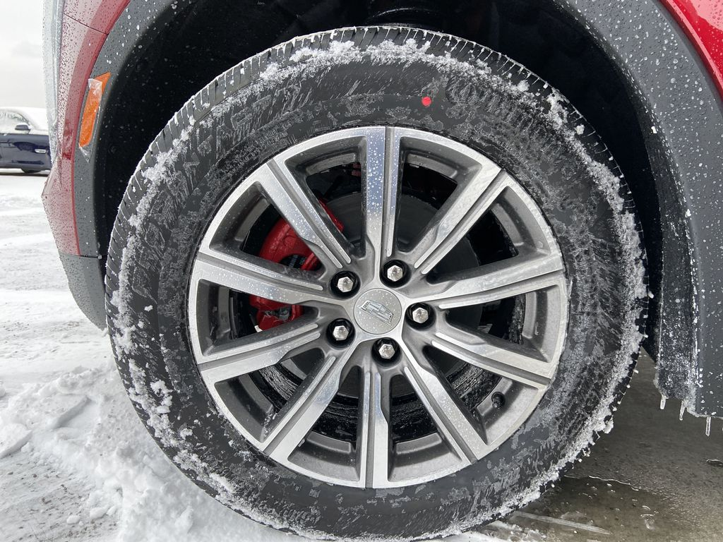Red[Infrared Tintcoat] 2021 Cadillac XT4 Sport Left Front Rim and Tire Photo in Calgary AB