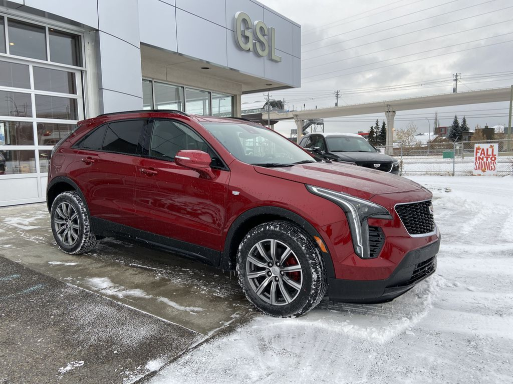 Red[Infrared Tintcoat] 2021 Cadillac XT4 Sport Right Front Corner Photo in Calgary AB