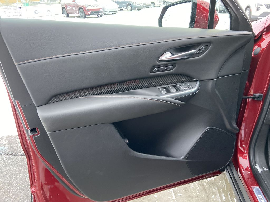 Red[Infrared Tintcoat] 2021 Cadillac XT4 Sport Left Front Interior Door Panel Photo in Calgary AB
