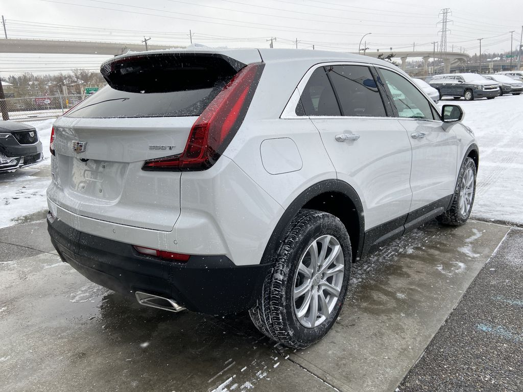White[Crystal White Tricoat] 2021 Cadillac XT4 Luxury Right Rear Corner Photo in Calgary AB