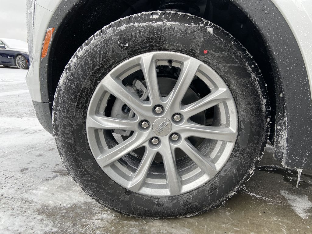 White[Crystal White Tricoat] 2021 Cadillac XT4 Luxury Left Front Rim and Tire Photo in Calgary AB