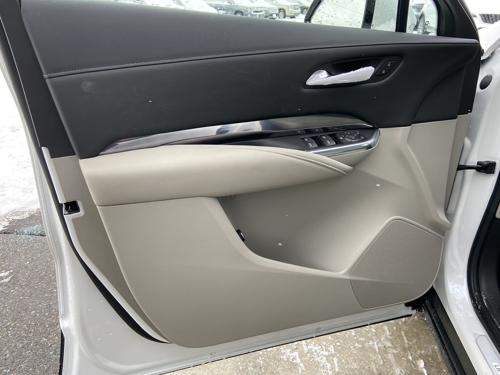 White[Crystal White Tricoat] 2021 Cadillac XT4 Luxury Left Front Interior Door Panel Photo in Calgary AB
