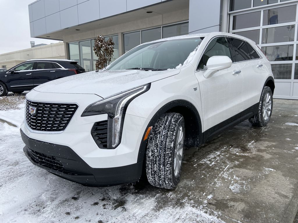 White[Crystal White Tricoat] 2021 Cadillac XT4 Luxury Left Front Head Light / Bumper and Grill in Calgary AB