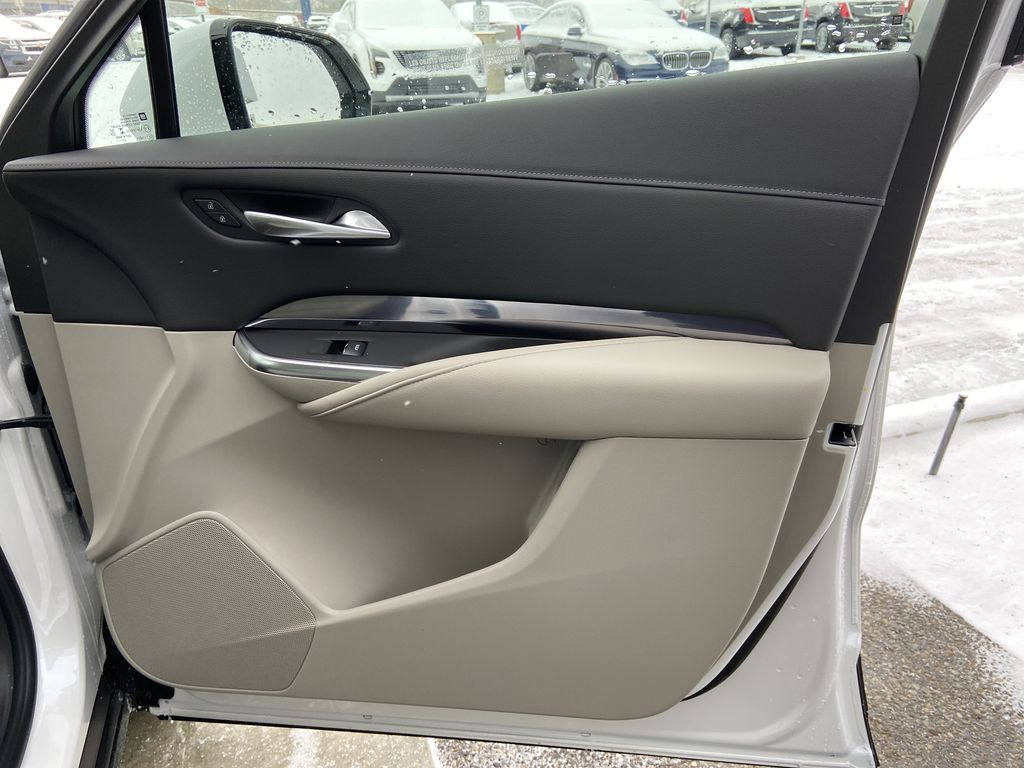 White[Crystal White Tricoat] 2021 Cadillac XT4 Luxury Right Front Interior Door Panel Photo in Calgary AB