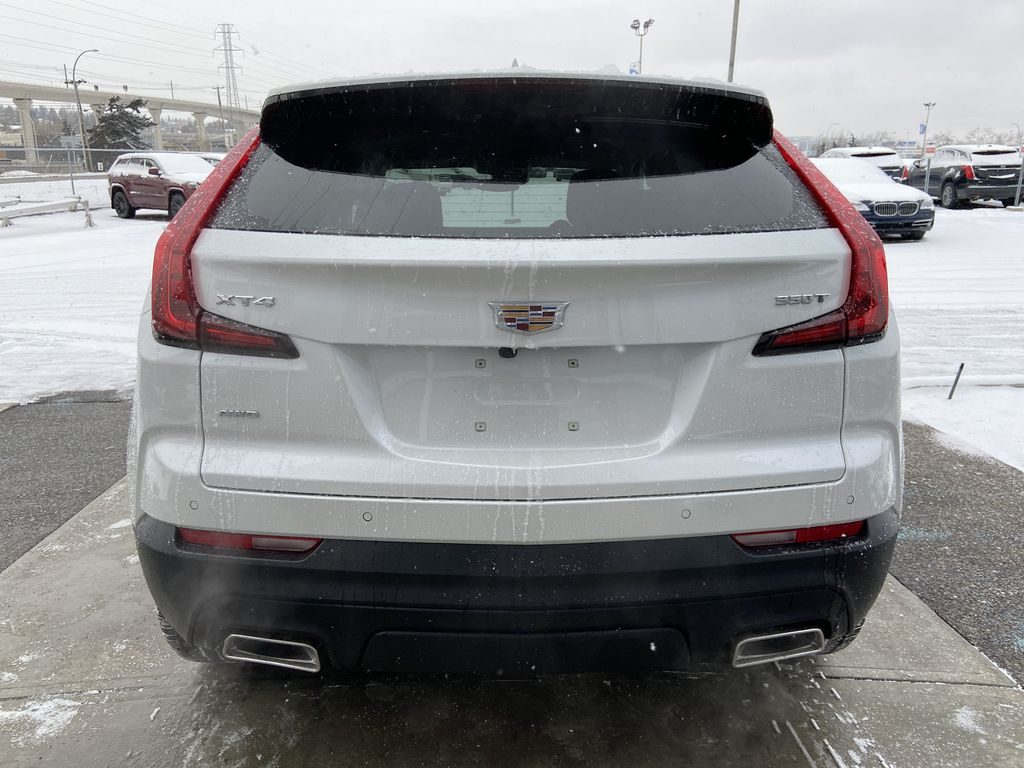 White[Crystal White Tricoat] 2021 Cadillac XT4 Luxury Rear of Vehicle Photo in Calgary AB