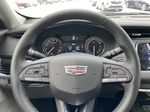White[Crystal White Tricoat] 2021 Cadillac XT4 Luxury Steering Wheel and Dash Photo in Calgary AB