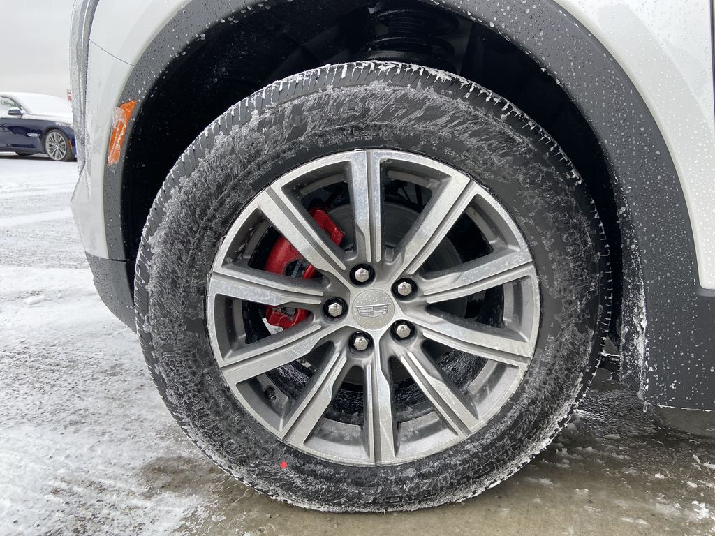 White[Crystal White Tricoat] 2021 Cadillac XT4 Sport Left Front Rim and Tire Photo in Calgary AB