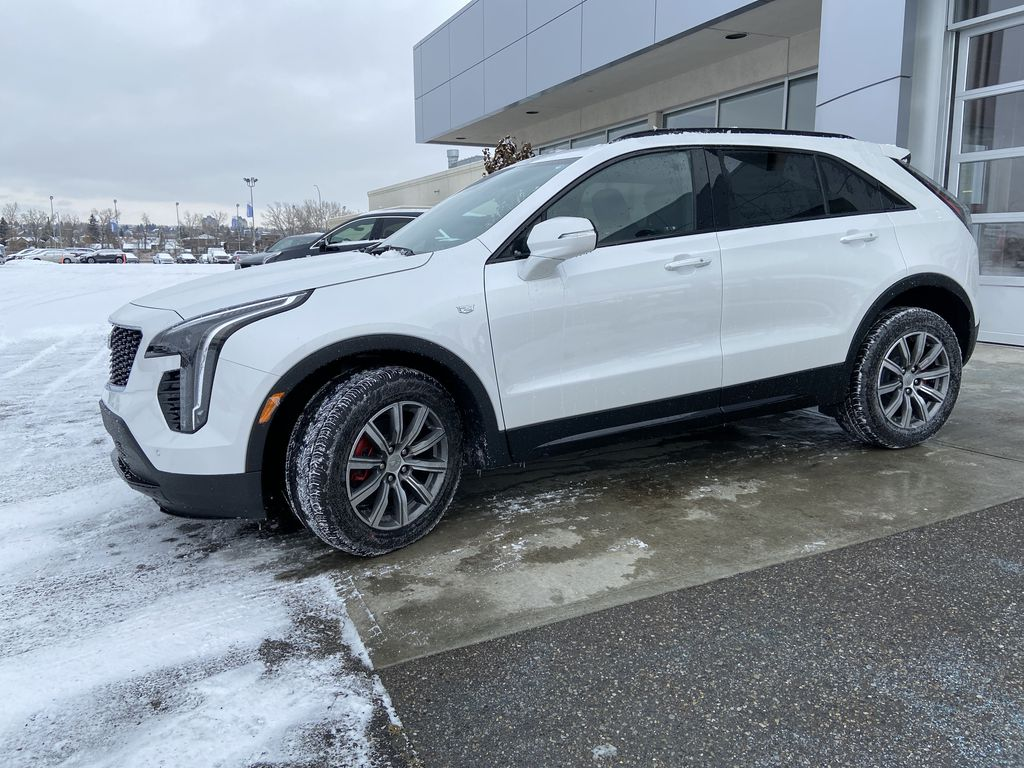 White[Crystal White Tricoat] 2021 Cadillac XT4 Sport Left Front Corner Photo in Calgary AB