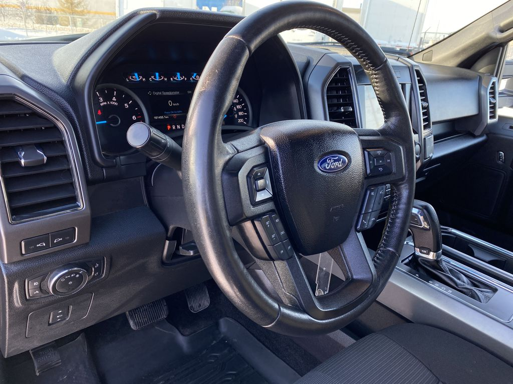 Red[Race Red] 2017 Ford F-150 Steering Wheel and Dash Photo in Edmonton AB