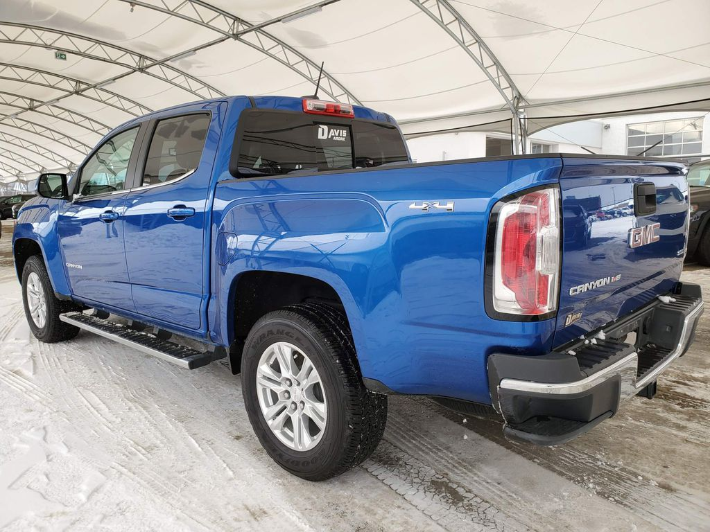 Blue 2019 GMC Canyon Strng Wheel/Dash Photo: Frm Rear in Airdrie AB