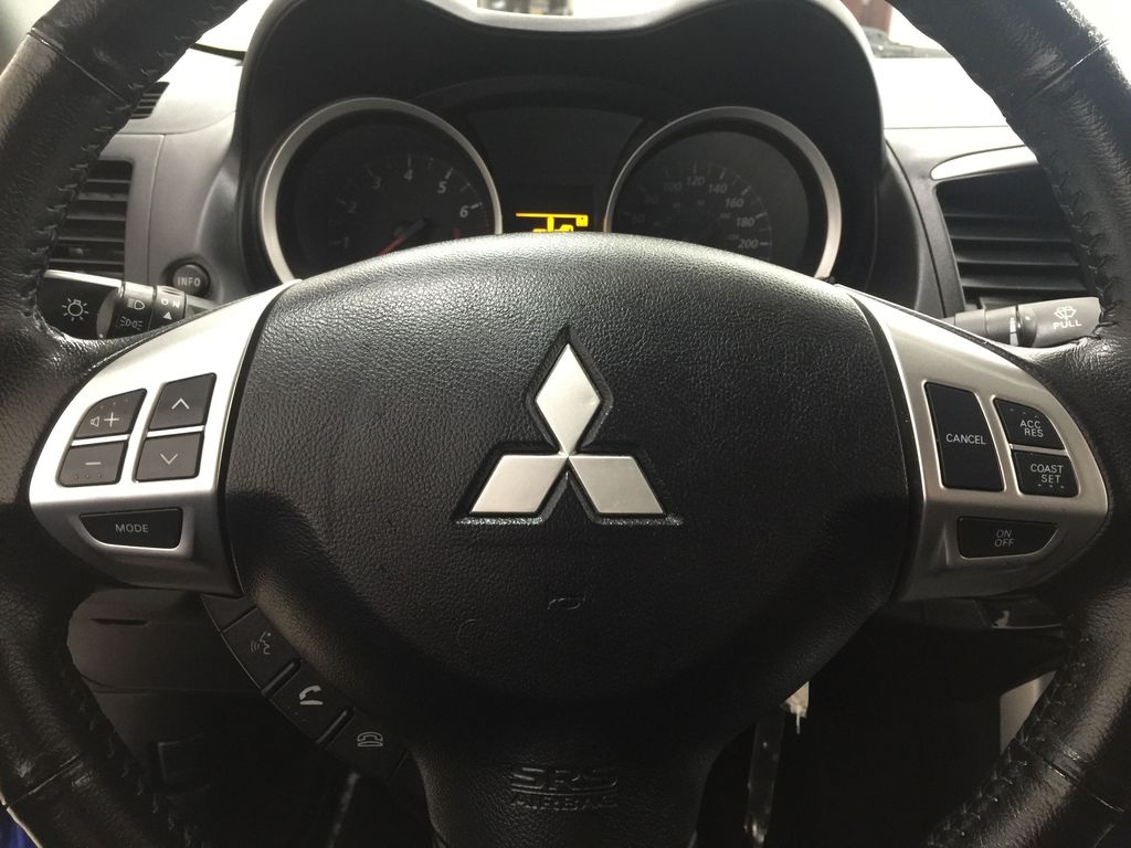 Blue[Octane Blue Pearl] 2016 Mitsubishi Lancer SE Limited FWD Steering Wheel and Dash Photo in Sherwood Park AB