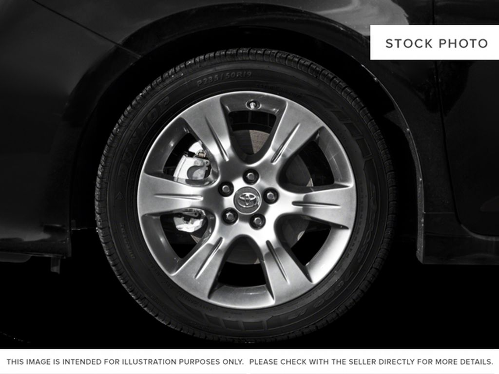 White[Alpine White] 2016 Toyota Sienna Left Front Rim and Tire Photo in Fort Macleod AB