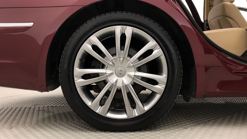 Red[Cabernet Red Pearl Mica] 2013 Hyundai Genesis Sedan 3.8 w/ Technology Package - Leather, Sunroof Right Rear Rim and Tire Photo in Winnipeg MB
