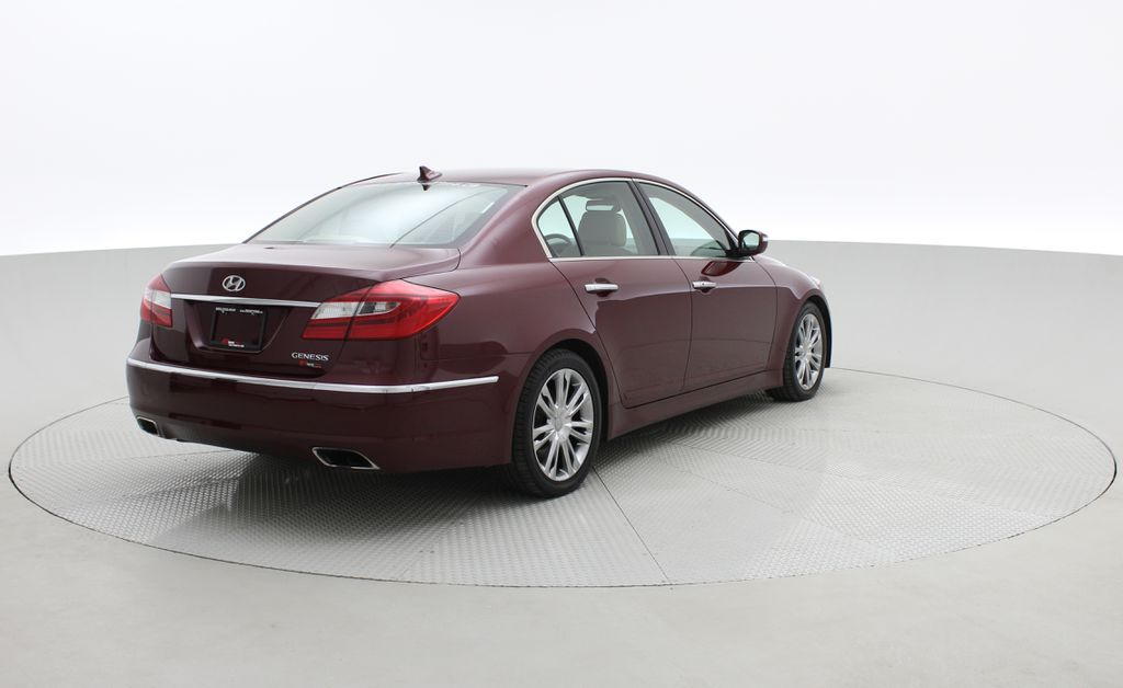 Red[Cabernet Red Pearl Mica] 2013 Hyundai Genesis Sedan 3.8 w/ Technology Package - Leather, Sunroof Right  Rear Corner Photo in Winnipeg MB