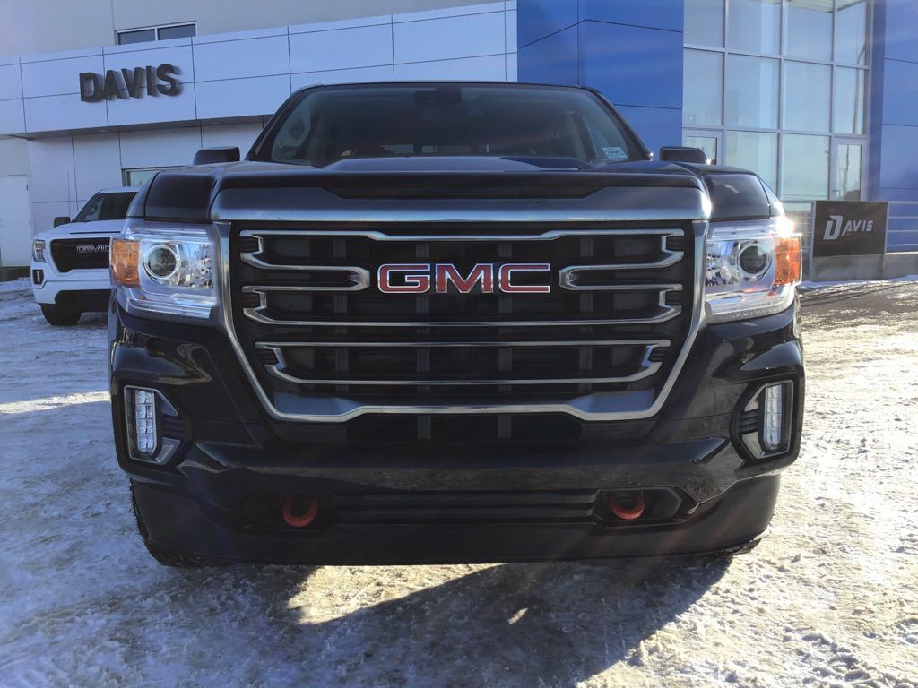 Black 2021 GMC Canyon Left Front Head Light / Bumper and Grill in Brooks AB