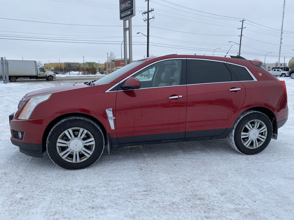 Red[Crystal Red Tintcoat] 2011 Cadillac SRX Left Side Photo in Edmonton AB