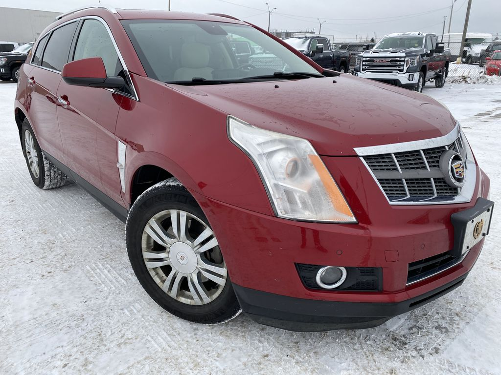 Red[Crystal Red Tintcoat] 2011 Cadillac SRX