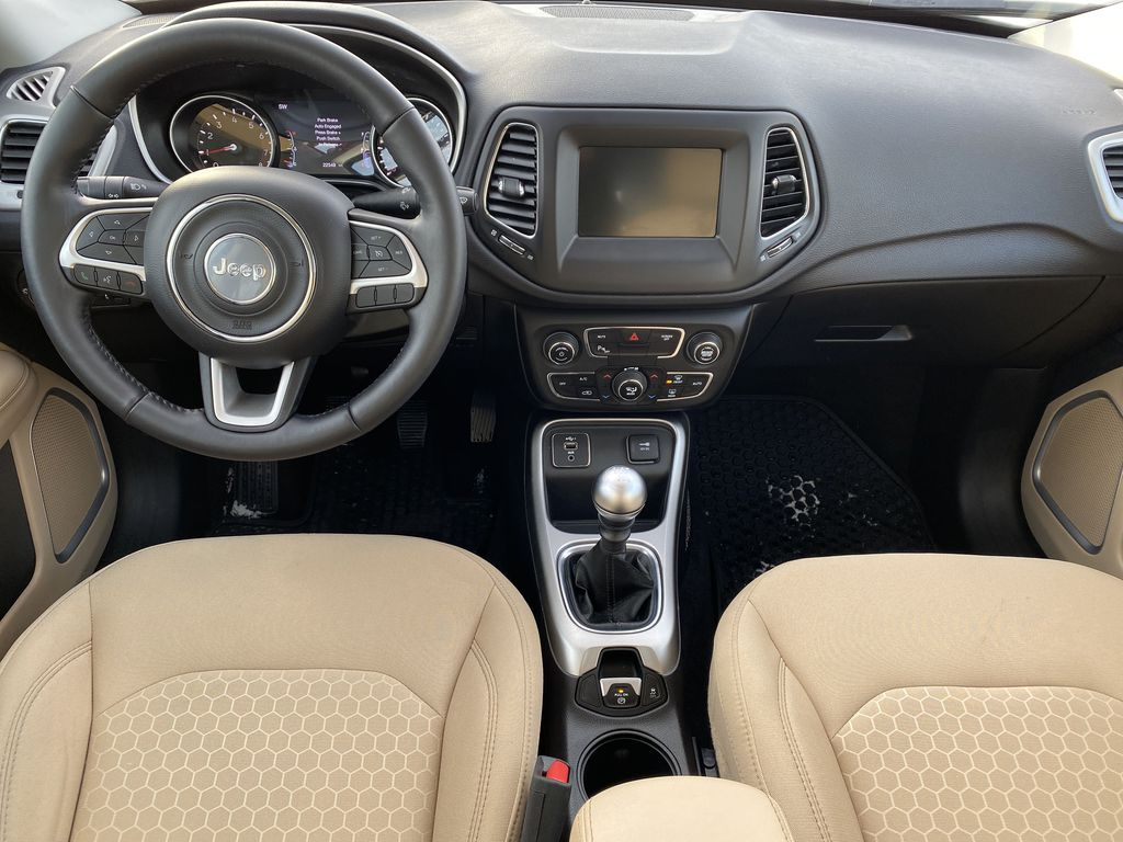 Green[Olive Green Pearl] 2019 Jeep Compass Strng Wheel/Dash Photo: Frm Rear in Edmonton AB