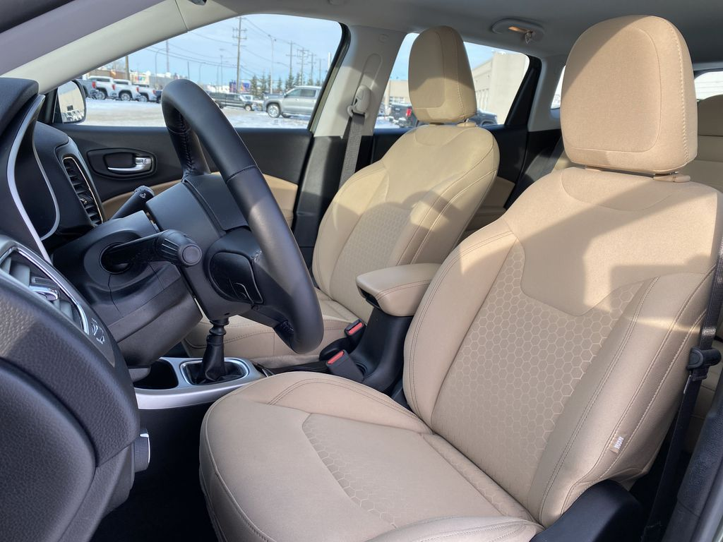Green[Olive Green Pearl] 2019 Jeep Compass Left Front Interior Photo in Edmonton AB