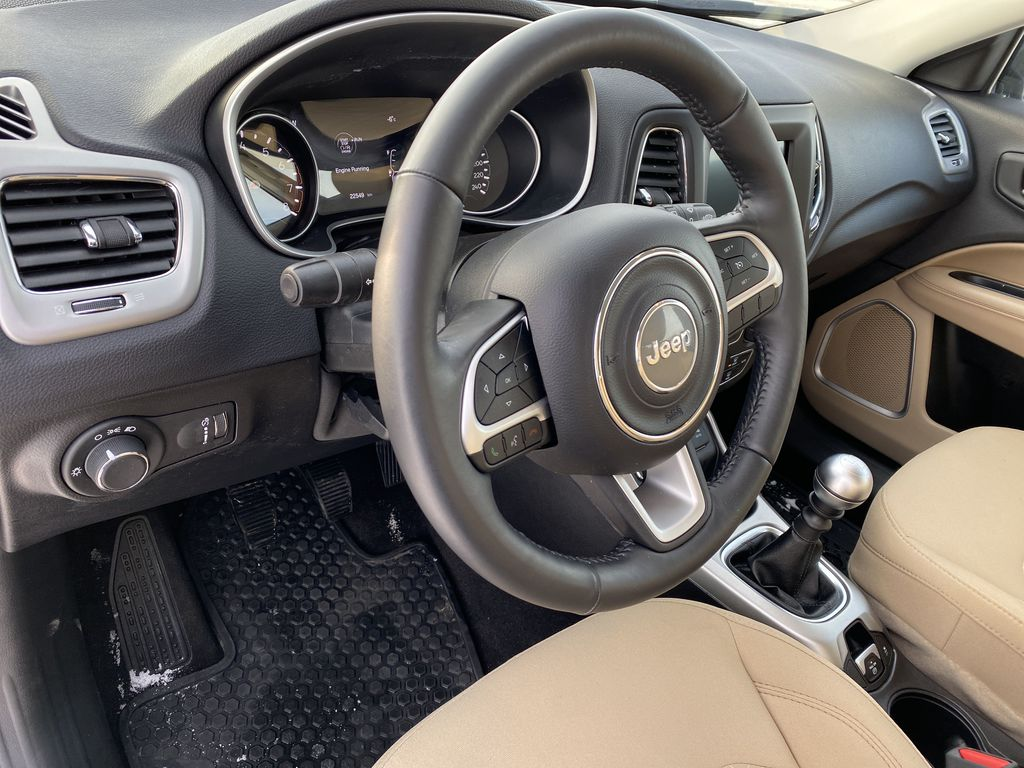 Green[Olive Green Pearl] 2019 Jeep Compass Steering Wheel and Dash Photo in Edmonton AB