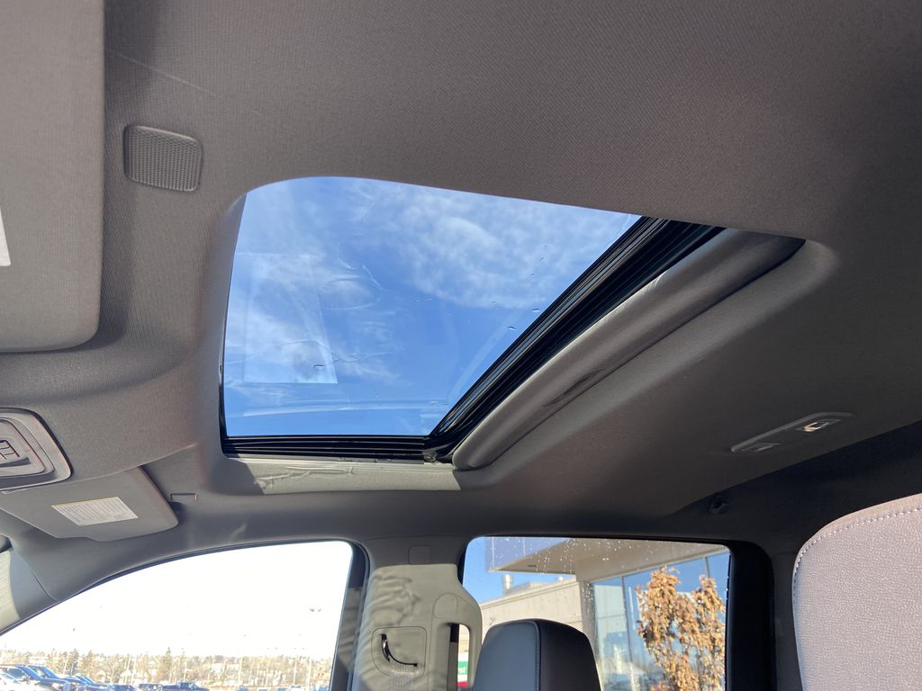 White[Summit White] 2021 Chevrolet Silverado 1500 LT Trail Boss Sunroof Photo in Calgary AB