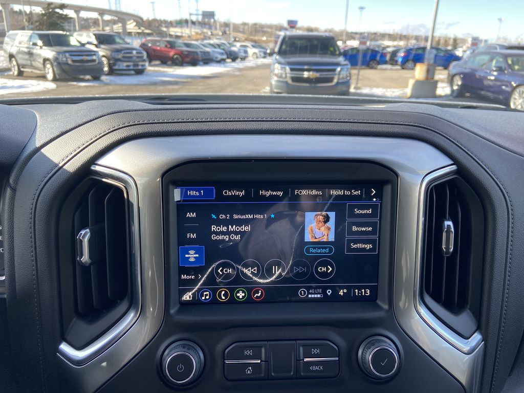 White[Summit White] 2021 Chevrolet Silverado 1500 LT Trail Boss Radio Controls Closeup Photo in Calgary AB