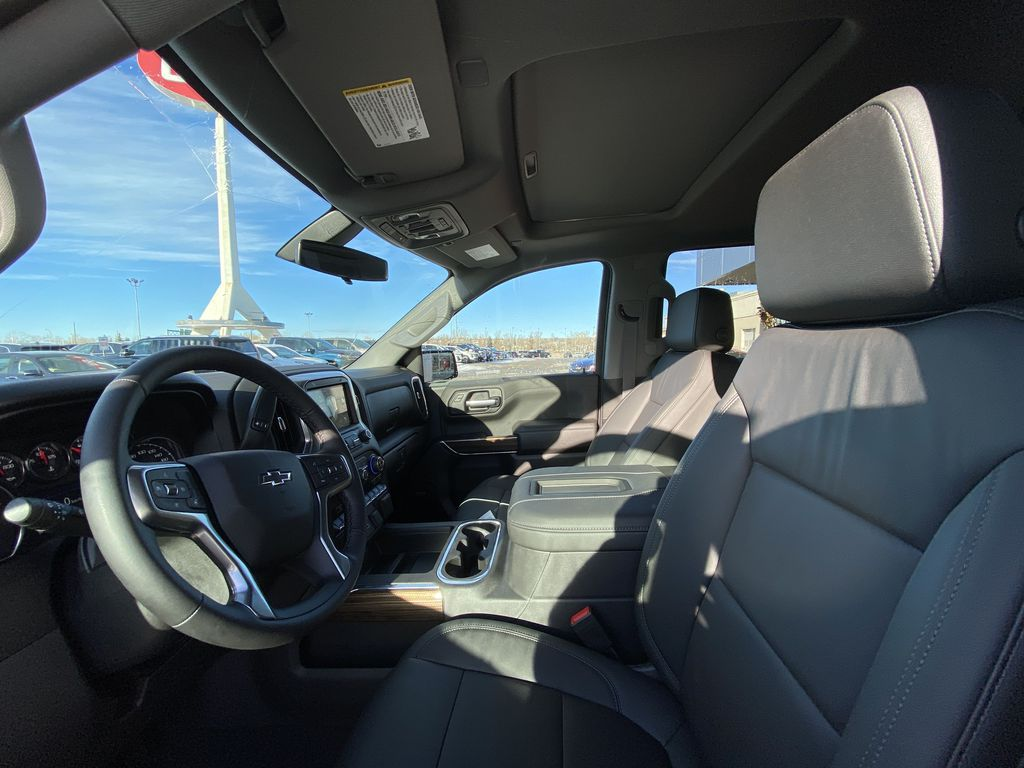 White[Summit White] 2021 Chevrolet Silverado 1500 LT Trail Boss Left Front Interior Photo in Calgary AB