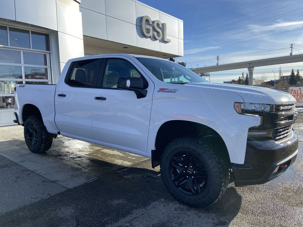 White[Summit White] 2021 Chevrolet Silverado 1500 LT Trail Boss Right Front Corner Photo in Calgary AB