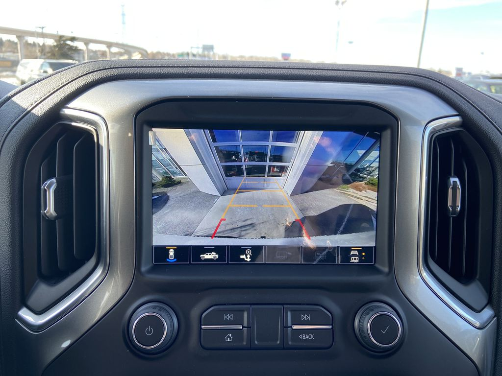 White[Summit White] 2021 Chevrolet Silverado 1500 LT Trail Boss Backup Camera Closeup Photo in Calgary AB