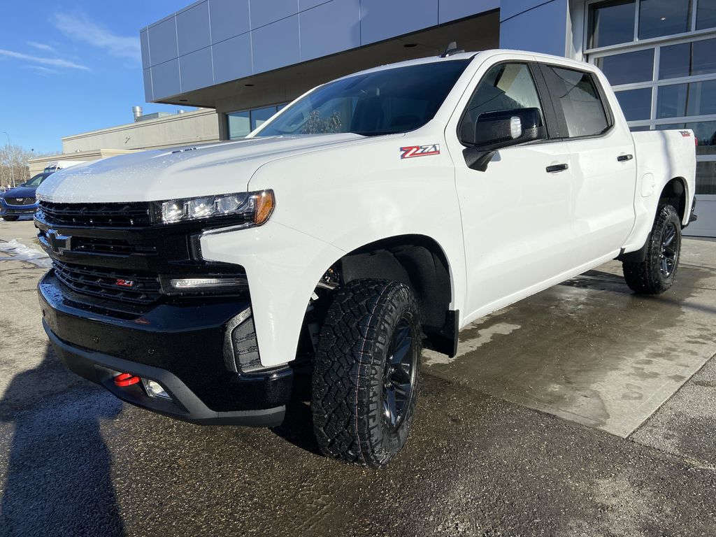 White[Summit White] 2021 Chevrolet Silverado 1500 LT Trail Boss Left Front Head Light / Bumper and Grill in Calgary AB