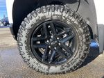 White[Summit White] 2021 Chevrolet Silverado 1500 LT Trail Boss Left Front Rim and Tire Photo in Calgary AB