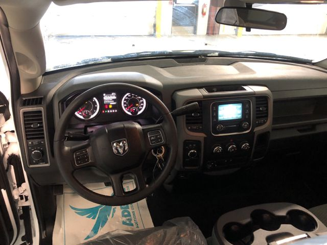 """White 2019 Ram 1500 Classic ST 4x4 Quad Cab 6'4"""" Box *Tow Package*Trailer Hitch*Bluetooth* Steering Wheel and Dash Photo in Brandon MB"""