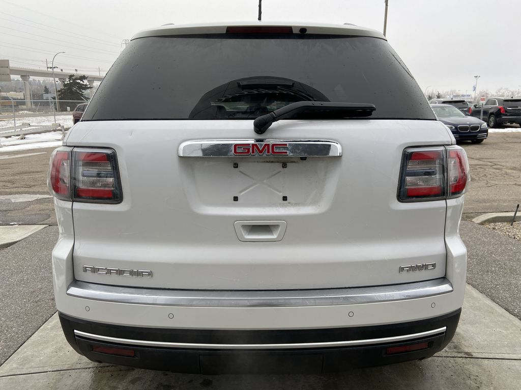 White[White Frost Tricoat] 2016 GMC Acadia SLE Rear of Vehicle Photo in Calgary AB