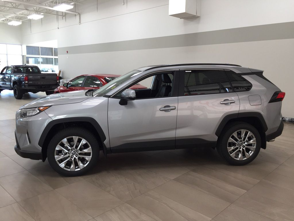 Silver[Silver Sky Metallic] 2021 Toyota RAV4 XLE Premium Left Side Photo in Sherwood Park AB