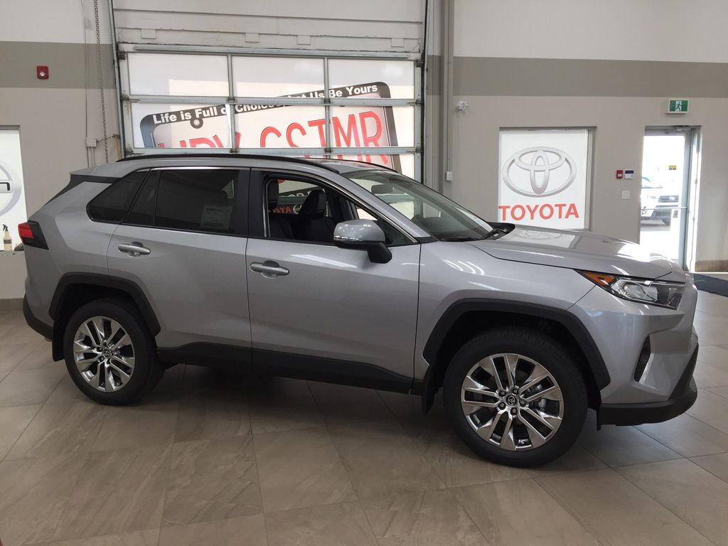 Silver[Silver Sky Metallic] 2021 Toyota RAV4 XLE Premium Right Side Photo in Sherwood Park AB