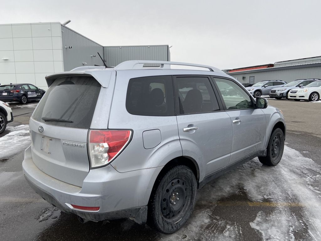 Silver 2013 Subaru Forester Left Front Rim and Tire Photo in Lethbridge AB