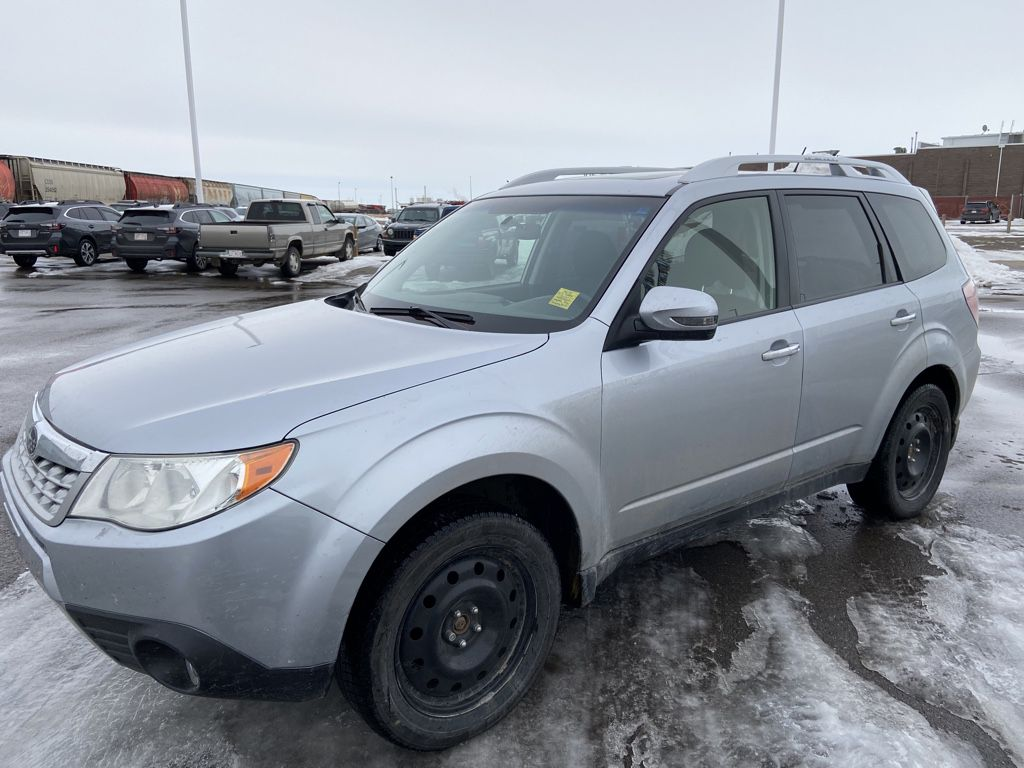 Silver 2013 Subaru Forester Left Front Head Light / Bumper and Grill in Lethbridge AB